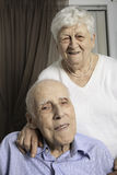 Portrait of a happy senior couple in apartement. A Portrait of a happy senior couple in apartement Royalty Free Stock Photography