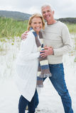 Portrait of a happy senior couple at beach Stock Images