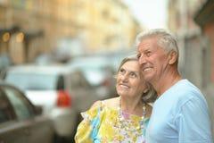 Senior couple on city street. Portrait of happy senior couple on city street Royalty Free Stock Photography