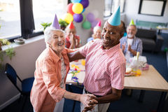 Portrait of happy senior couple dancing at party stock photo
