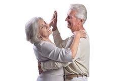 Portrait of happy senior couple dancing on white background royalty free stock photos