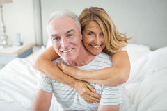 Portrait of happy senior couple embracing each other on bed Royalty Free Stock Photography