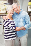 Portrait of happy senior couple embracing while holding hands Royalty Free Stock Photo