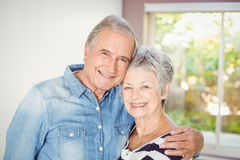 Portrait of happy senior couple embracing at home Royalty Free Stock Images
