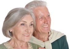 Portrait of happy senior couple embracing on white background stock images