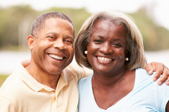 Portrait Of Happy Senior Couple In Garden Royalty Free Stock Photography
