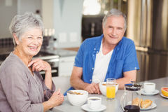 Portrait of happy senior couple having breakfast Royalty Free Stock Image