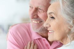 Portrait of a happy senior couple at home. Portrait of a happy beautiful senior couple posing at home stock images