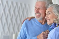 Happy senior couple hugging  at home Stock Image
