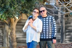 Senior couple relaxing by the park on sunny day. royalty free stock photography
