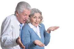 Portrait of happy senior couple looking down royalty free stock photography