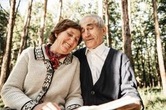 Happy senior couple walking in park stock images