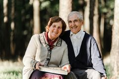 Happy senior couple walking in park royalty free stock images