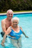 Portrait of happy senior couple in the pool Royalty Free Stock Photography