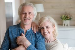 Portrait of hugging aged couple making family picture royalty free stock photo
