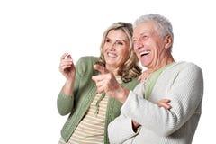 Portrait of happy senior couple posing on white background stock image