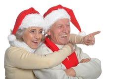Senior couple in Santa hats Stock Photos