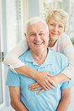 Portrait of happy senior couple smiling while hugging Royalty Free Stock Photo