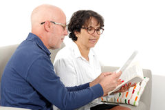 Portrait of a happy senior couple using tablet digital Royalty Free Stock Images