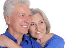 Portrait of happy senior couple on white background royalty free stock images