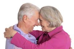Portrait of happy senior couple on white background stock photos