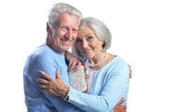 Portrait of happy senior couple on white background stock photo