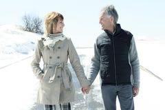 Portrait of happy senior couple in winter season Stock Images