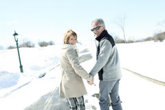 Portrait of happy senior couple in winter season Stock Photo