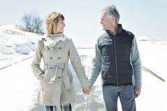 Portrait of happy senior couple in winter season Royalty Free Stock Photos