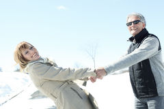 Portrait of happy senior couple in winter season Royalty Free Stock Image