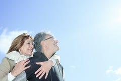 Portrait of happy senior couple in winter season Stock Image