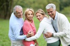 Portrait of happy senior couples outdoors Stock Images