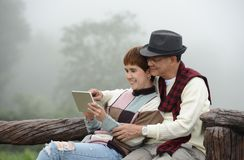 Romantic senior couples using digital tablet Royalty Free Stock Photo