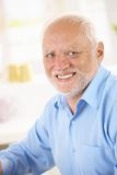 Portrait of happy senior man. Closeup portrait of happy senior man looking at camera royalty free stock image