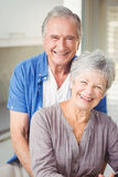 Portrait of happy senior man embracing wife Royalty Free Stock Photography
