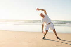 Portrait of happy senior man exercising against clear sky Stock Images