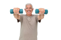 Portrait of a happy senior man exercising with dumbbells Royalty Free Stock Photo