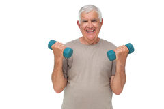 Portrait of a happy senior man exercising with dumbbells Stock Photography