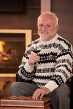 Portrait of happy senior man having wine Stock Photo