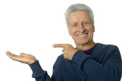 Happy senior man pointing Stock Photos