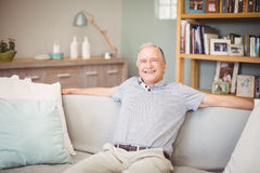 Portrait of happy senior man sitting at home Royalty Free Stock Image
