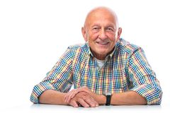 Portrait of a happy senior man smiling. Isolated on white stock image