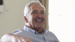 Senior man smiling at home stock video footage