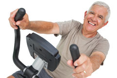 Portrait of a happy senior man on stationary bike Royalty Free Stock Photography