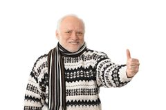 Portrait of happy senior man with thumb up. Portrait of happy senior man looking at camera, showing thumb up, laughing, isolated on white stock images