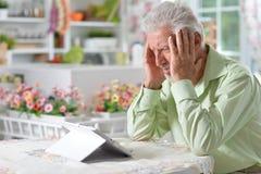 Man  using digital tablet. Portrait of a happy senior man using digital tablet Stock Photography