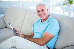 Portrait of happy senior man using digital tablet Stock Photography