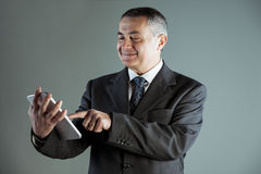 Portrait of a happy senior man using a tablet PC Stock Photos