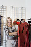 Portrait of a happy senior woman browsing in fashion boutique Royalty Free Stock Images
