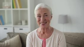 Portrait of happy senior woman face at home stock video footage
